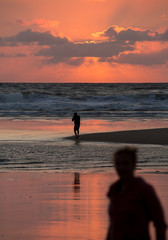 watching photographer in sunset at beach