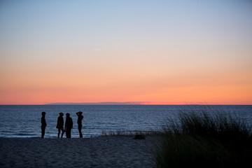friends at beach in sunset
