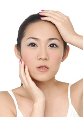 Young girl touching her pretty face with healthy skin -