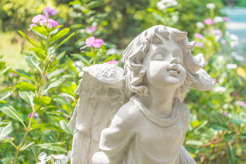 Fairy Statue in the garden with flower