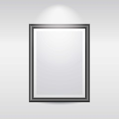 Blank Black picture frame on a wall in a gallery