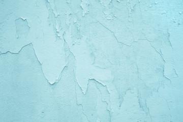 Hintergrund: alte Wand mit abgeblätterter Farbe in türkis