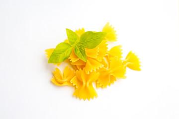 Bowtie pasta farfalle and basil