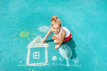Nice Caucasian little girl draw chalk house image