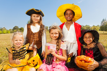 Wall Mural - Multinational kids in Halloween costumes