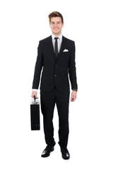 Portrait Of Confident Businessman Carrying Briefcase