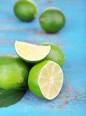 Fresh juicy limes on old wooden table