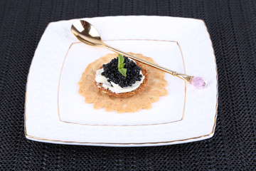 Black caviar with crispy bread