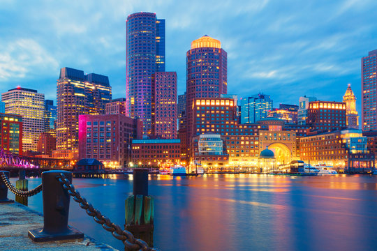 Boston Harbor and Financial District at sunset.