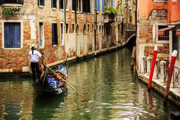 Spoed Fotobehang Venetie Venice, Italy - Gondolier and historic tenements
