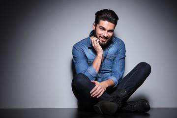 Man with beard sitting