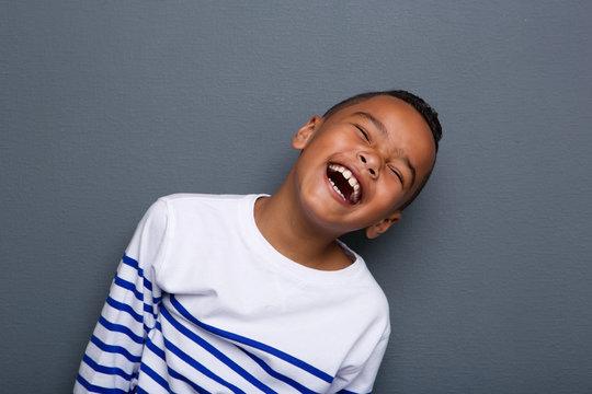 Close up portrait of a happy little boy smiling
