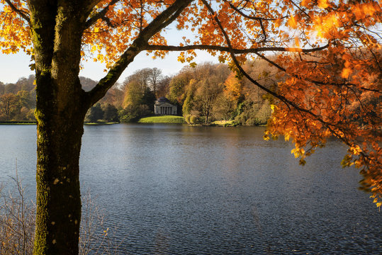 Trees and main lake in Stourhead Gardens during Autumn.