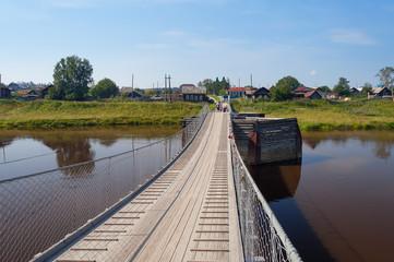 Old suspension bridge over the River Tura