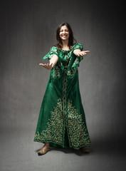 girl with traditional arab dress dancing