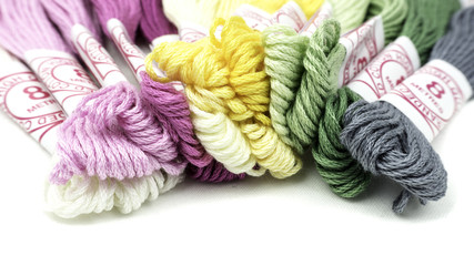 Slightly defocused strands of colourful cotton yarn