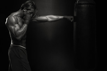 MMA Fighter Practicing With Boxing Bag
