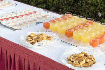 Glasses of with exotic drinks and cookies on the decorated table
