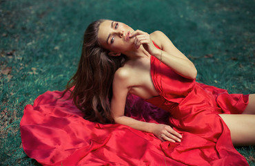 Attractive woman wearing red dress