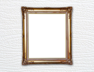 golden frame on wood wall