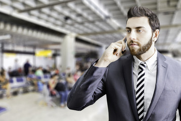Young businessman on the phone at the airport