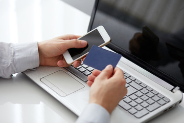 Male hand holding a mobile phone and payment