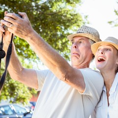 Happy senior couple posing for a selfie
