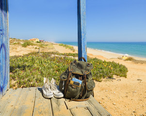 Backpacking traveller in a beach rest. Tavira island, Algarve