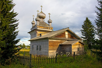 traditional old wooden church behind the fence