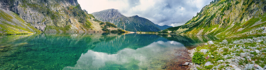 Panoramic view of mountain lake in Tatra mountains Wall mural