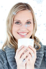 Smiling woman drinking a hot coffee