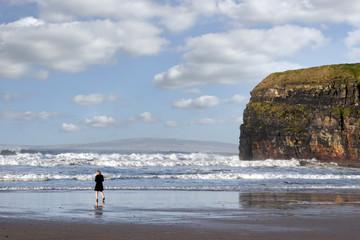 woman in high heels on beach