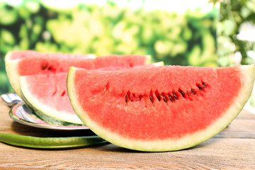 Fresh slice of watermelon on table outdoors, close up