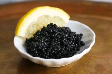 Black caviar and slice of lemon