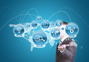 Businessman hold cloud of application icon and world map