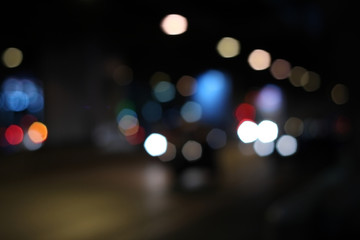Multicolored defocused bokeh lights of night street.