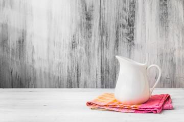 Still life white jug kitchen cloth