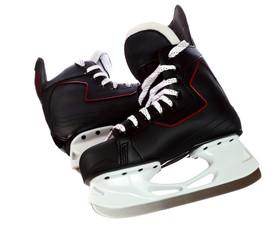 Pair of black hockey skates isolated on white background