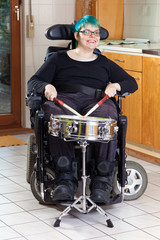 Happy young woman with infantile cerebral palsy.