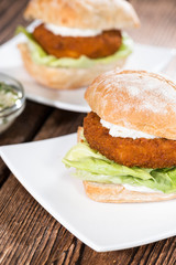 Homemade Fishburger on wooden background