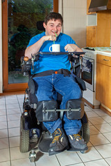 Young man with infantile cerebral palsy.