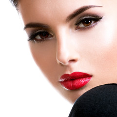Beautiful young fashion woman with glamour makeup.