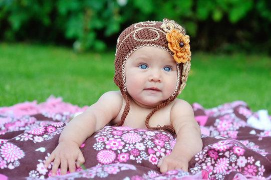baby girl outside in a handmade