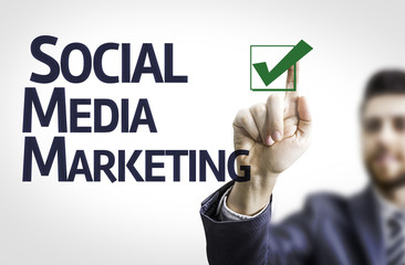 Business man pointing the text: Social, Media, Marketing