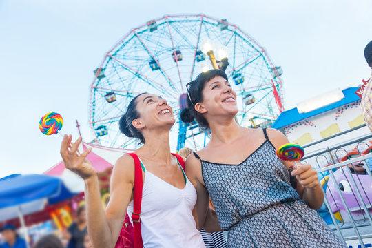 Happy Young Women at Luna Park
