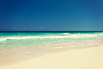 blue sea or ocean, white sand and sky