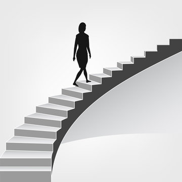 woman walking up on spiral staircase