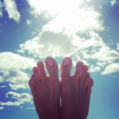 Relaxation foot in sky
