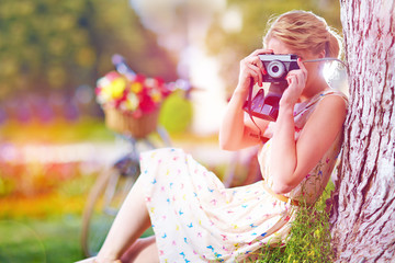 woman with camera relaxing after bicycle ride