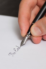 """Fountain pen writing the words """"The End"""""""